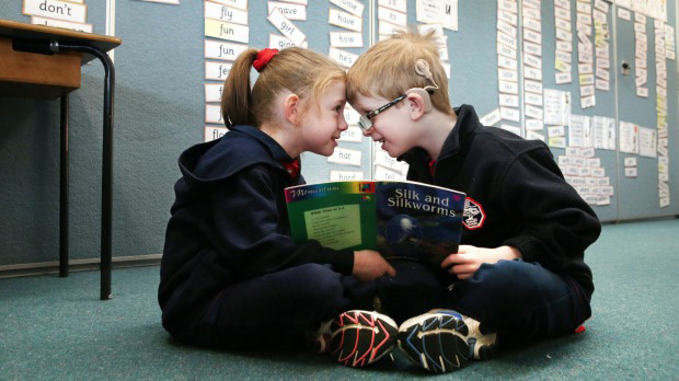 Two children learning from each other – one has a cochlear implant.